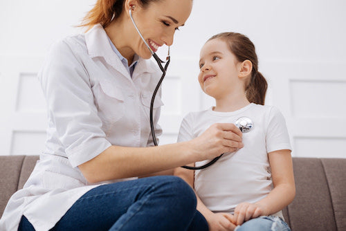 child respiratory health check with doctor