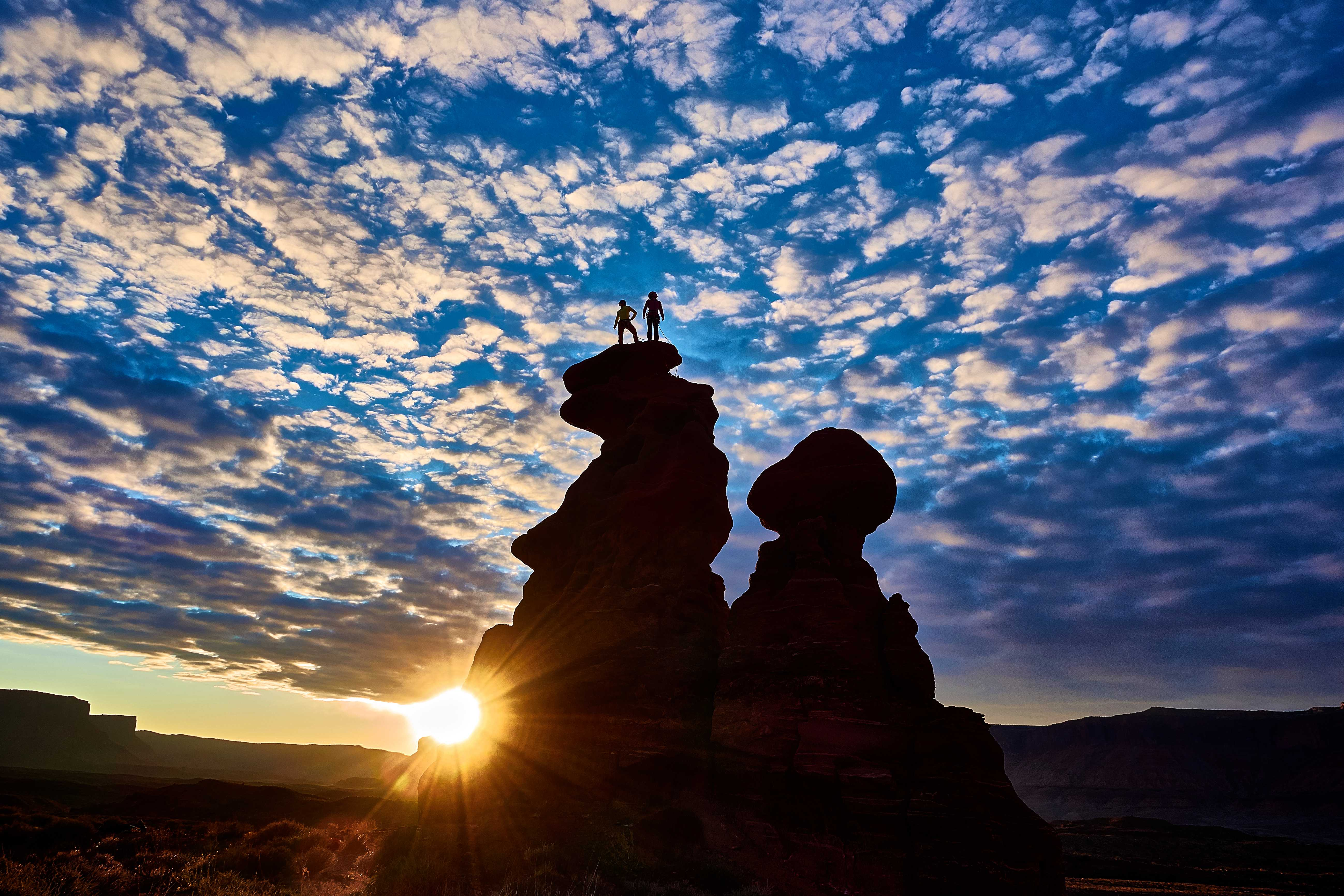 Two Rock Climber at the Top Of a Boulder