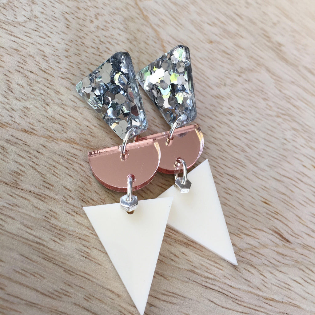 Neutral Metallic Triangles