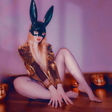 Load image into Gallery viewer, melissa in halloween costume with black shiny bunny ears an fishnets and golden bodysuit with hair covering breasts surrounded by pumpkins  by MelKimBrown - worn panty seller - used panties Mel Kim Brown MelKim Brown Mel KimBrown Mel Brown
