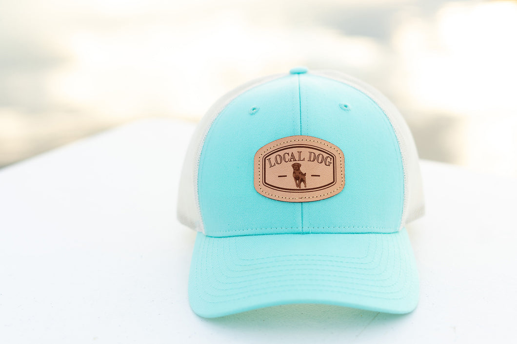 Aruba Blue Trucker Hat with local dog leather patch