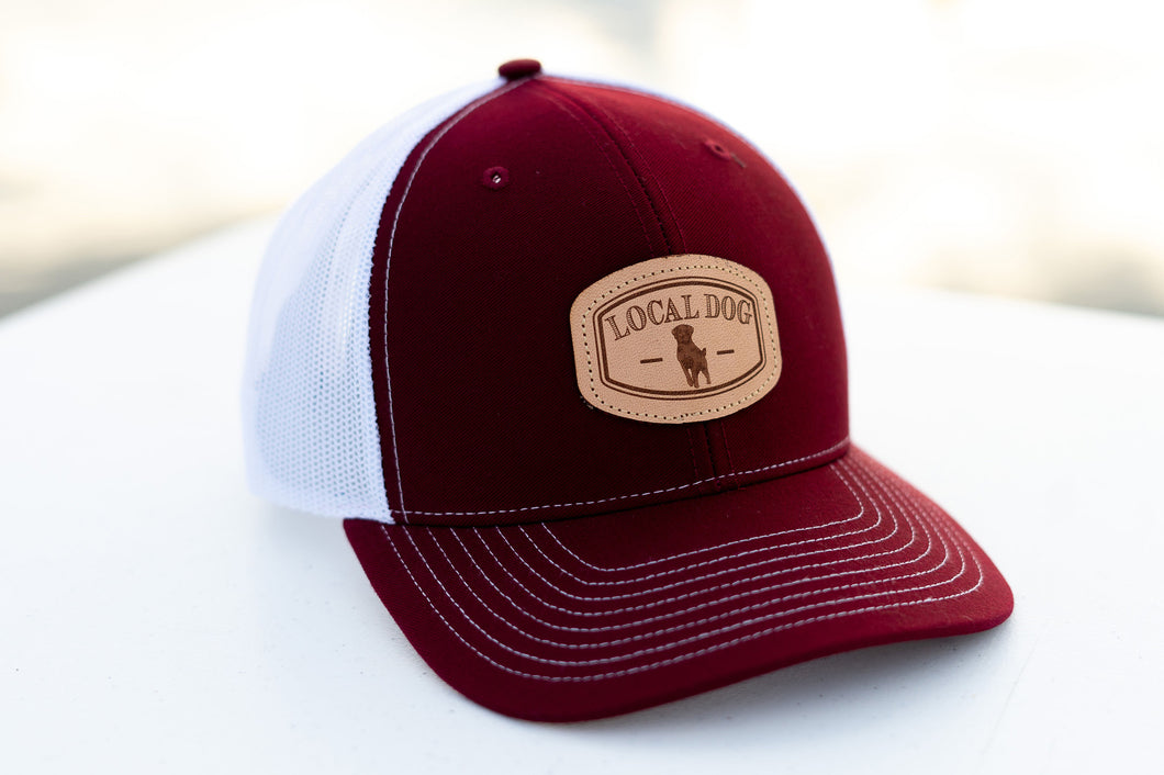 Cardinal Red Trucker Hat with local dog leather patch