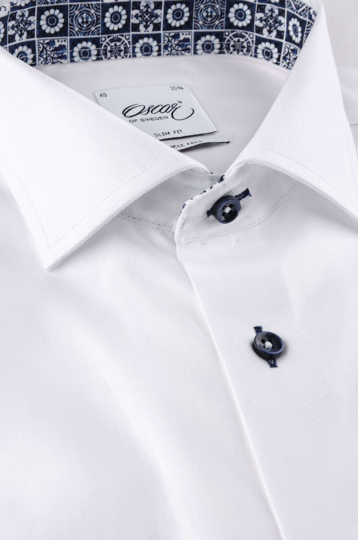 White slim fit shirt with navy contrast details