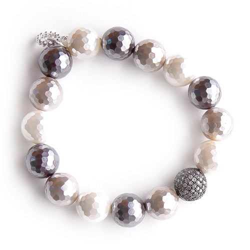 Beautiful 12 mm faceted agate beads with a multi-colored mother of pearl coating gives this bracelet its iridescent beauty.  As a luxurious extra, it also features a gunmetal micropave bead that gives the bracelet even more sparkle!  PowerBeads by Jen