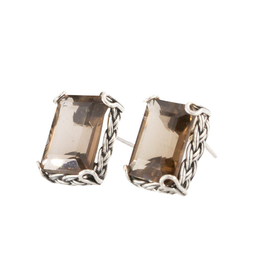 a rectangular 14x12mm Faceted Smoky Topaz gemstone set in a braided single bezel setting and securely held by double wire loop prongs.  For pierced ears only.