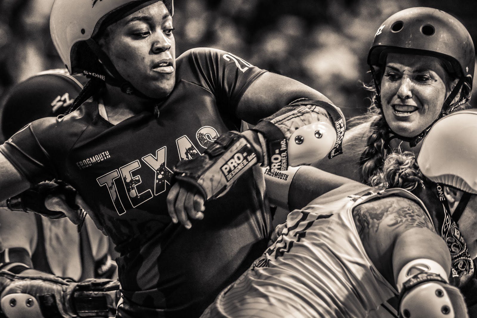 Texas Rollergirls skater Freight Train amid a pack – a moment caught by Michele J Hale that she hopes will remind skaters of their feelings during the game or in that moment. ©Michele J Hale
