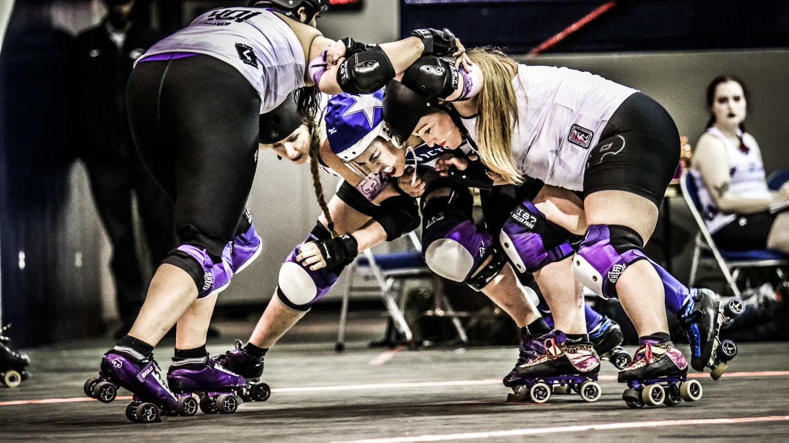 """""""I SHALL PASS!"""" – is what we are imagining Sarah Love (jamming for VRDL Roller Derby) is thinking while gritting her teeth, pushing through a tough Rose City Rollers wall. ©Michele J Hale"""
