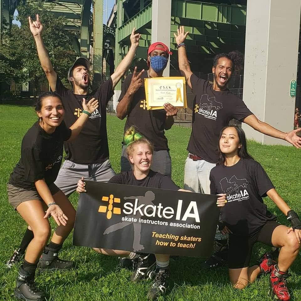 B000M (centre, front) & her classmates after finalizing their Skate IA skate instructor class. ©B000M