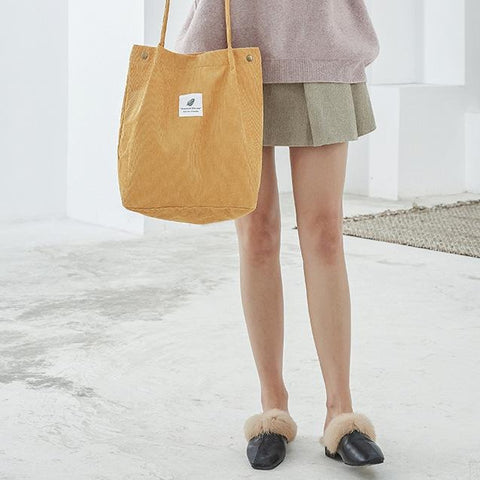 woman with yellow tote bag