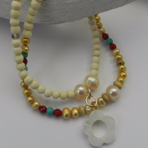 Bone with pearls, coral and turquoise beaded bracelet
