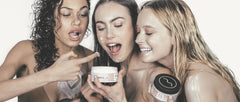 Girls with body cream on face and about to eat body cream