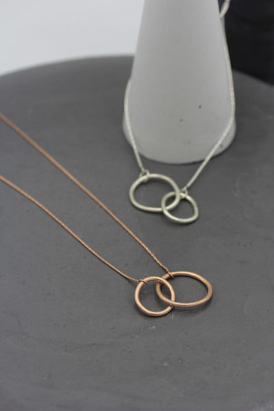 Infinity pendant necklace with organic interlocked loops in silver or rose gold