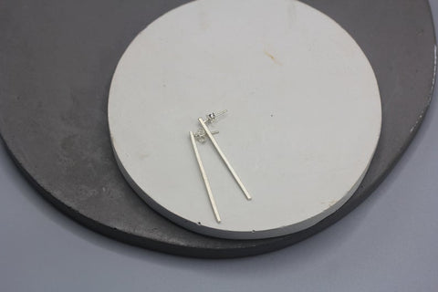 Long line stud earrings in silver or half-coated in gold or rhodium