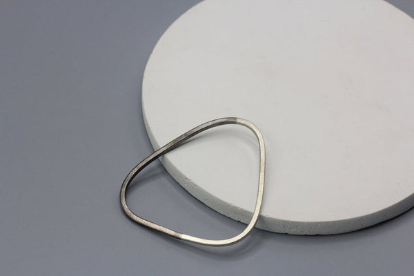 Handmade triangle shape silver bangle in partial rhodium