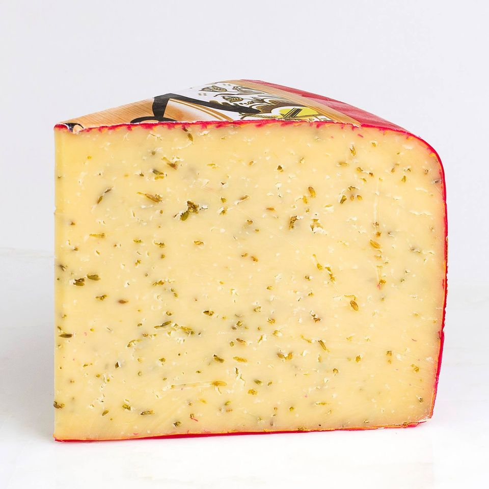 Firm yellow cheese speckled with cumin seeds