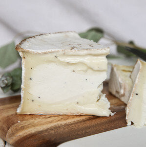 soft goat's cheese flecked with truffles