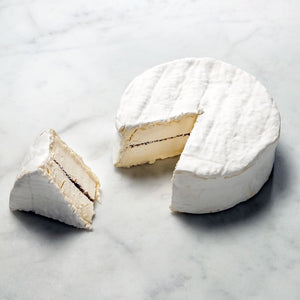 Soft cheese with a layer of truffles in the center
