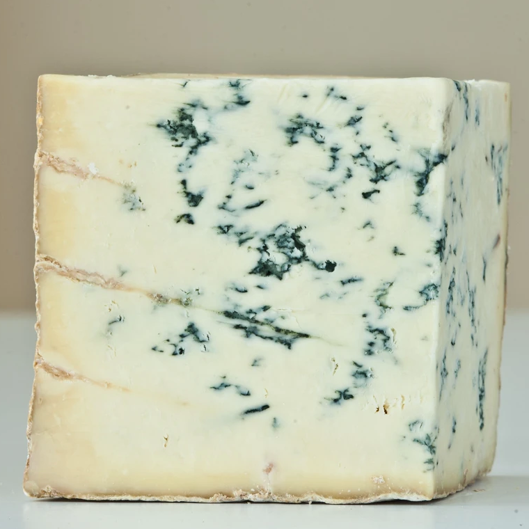wedge of pale yellow blue cheese