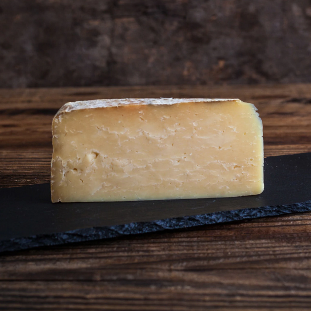 Wedge of crumbly cheddar cheese