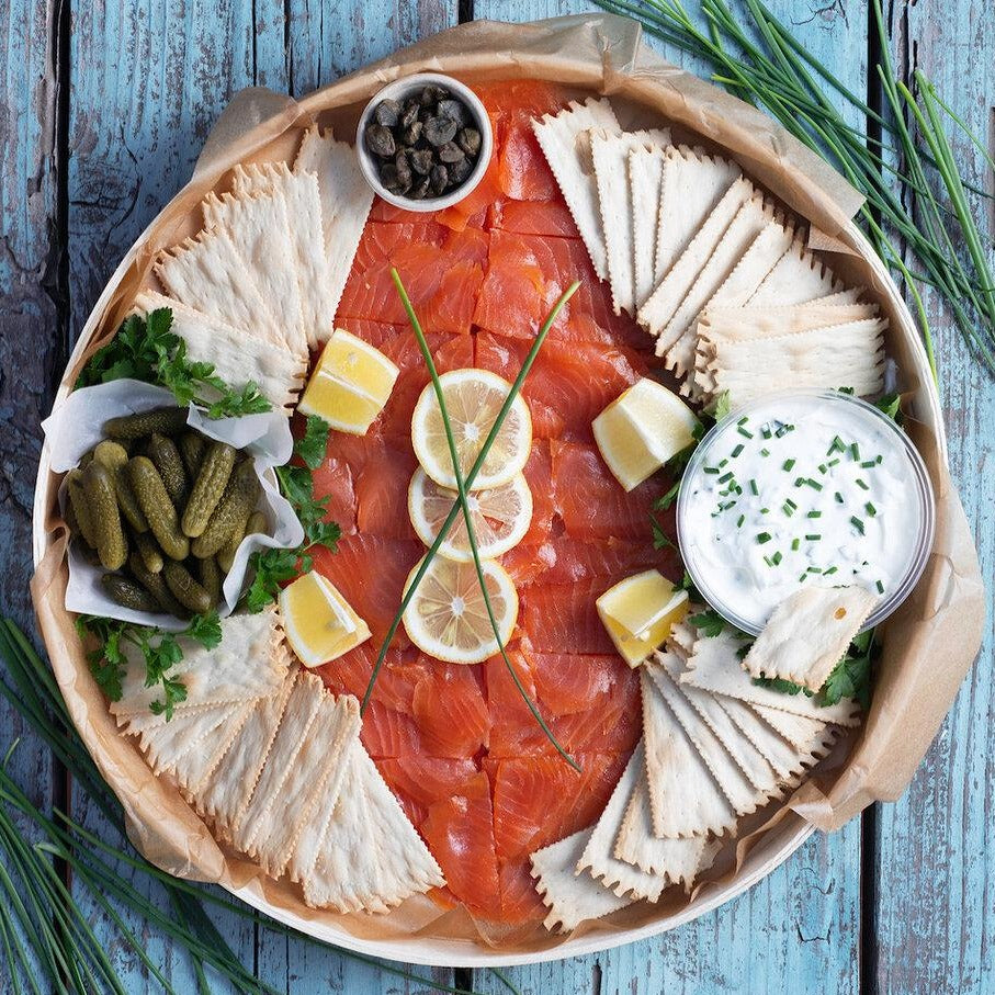 Platter with smoked salmon, crackers, cr�me fraiche, capers, and pickles