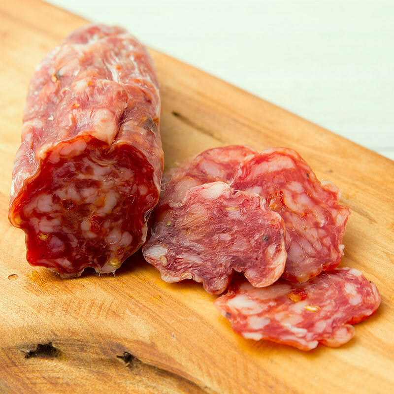 Spicy bright orange salami