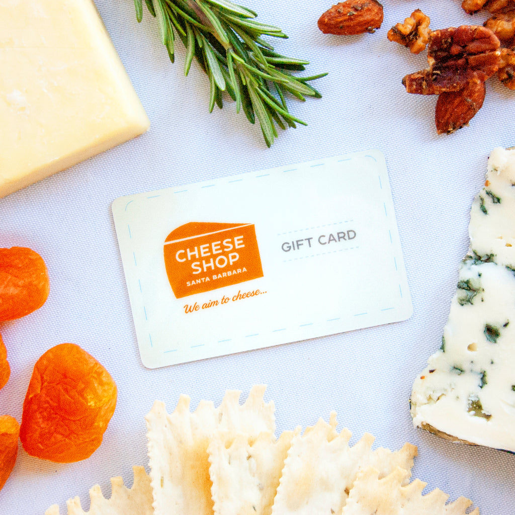 Gift card next to cheese, nuts and fruit