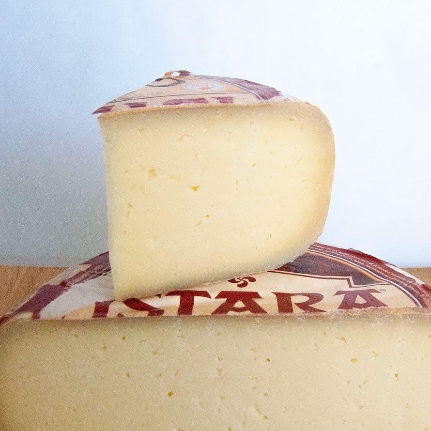 Firm yellow sheep's milk cheese with red and white label