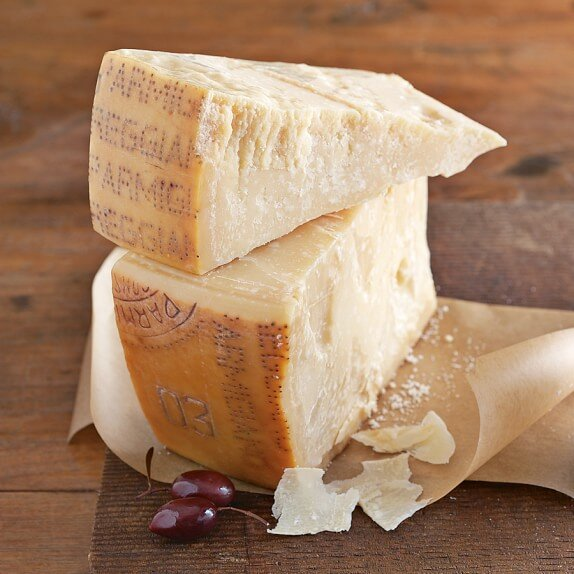 Two wedges of parmigiano-reggiano cheese