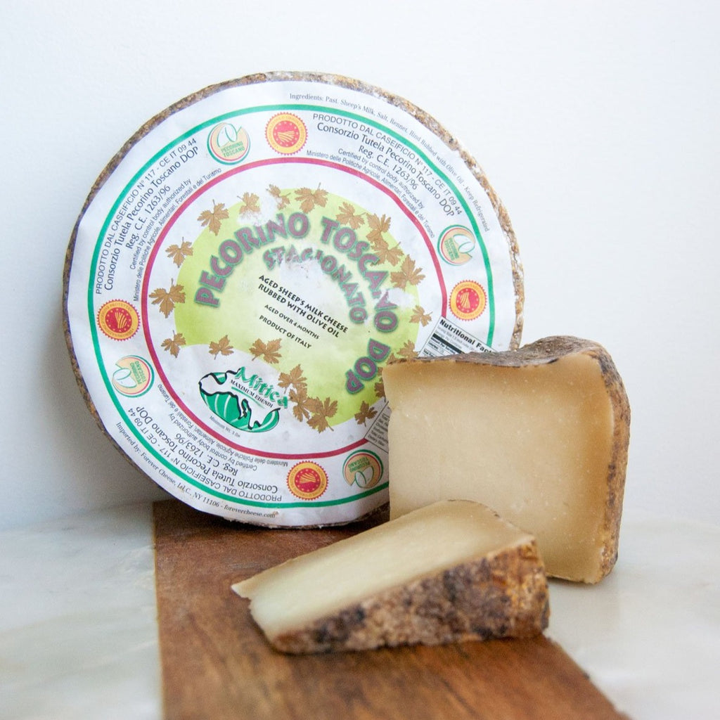 Wheel of firm sheep's milk cheese with a brown rind