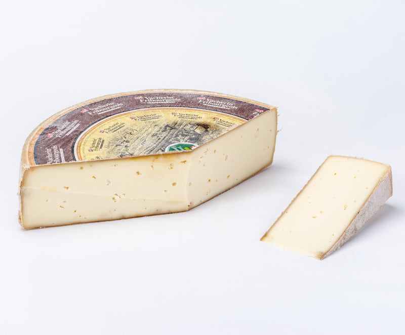 Large wheel of firm alpine cheese