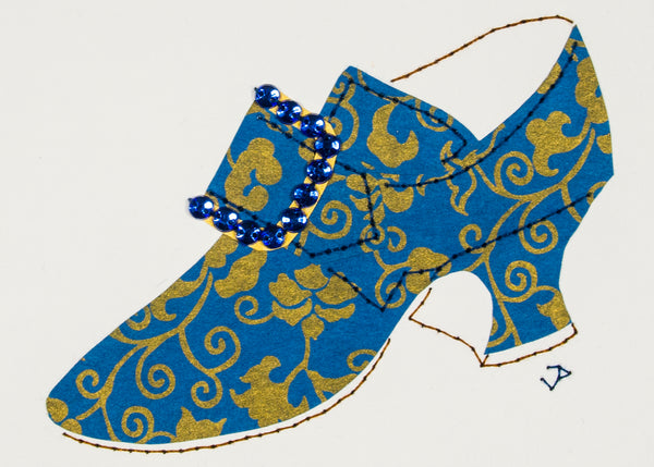 Hand-stitched 1760s shoe in blue paper patterned with bronze flowers and vines and accented with a rhinestone buckle