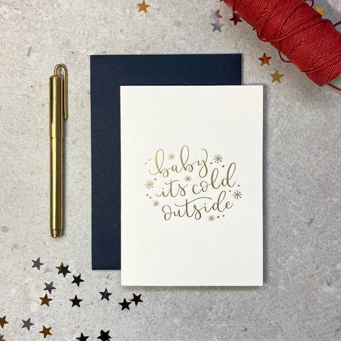 'baby it's cold outside' letterpress foiled ivory card