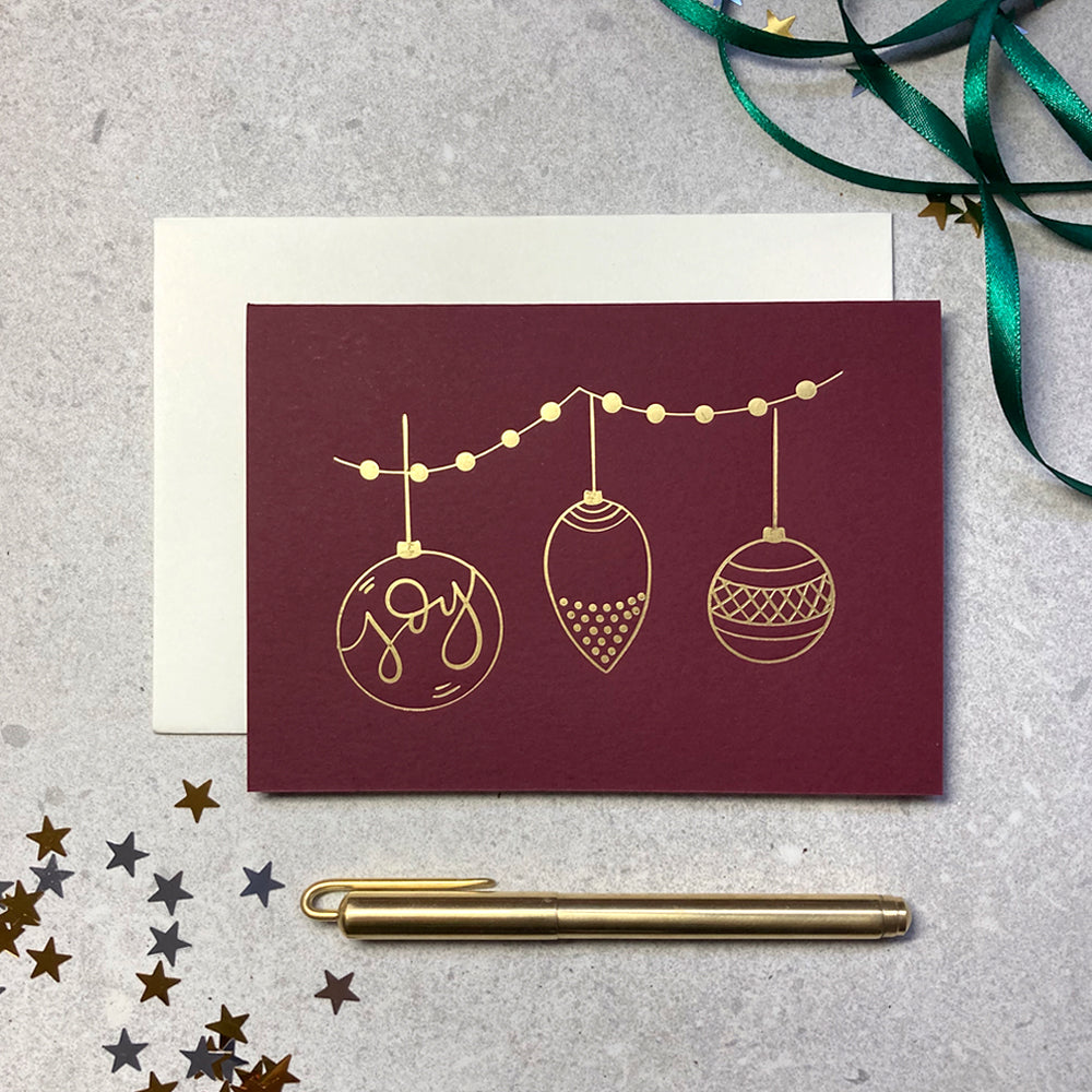 Christmas baubles illustration letterpress foiled red card