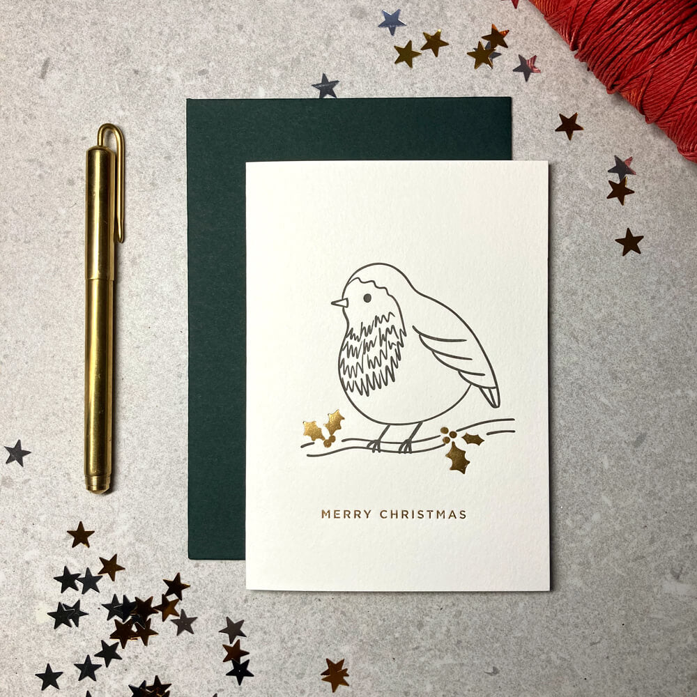 Illustrated robin on a branch letterpress printed ink and foil ivory card