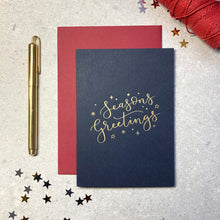 Load image into Gallery viewer, 'season's greetings' letterpress foiled navy card