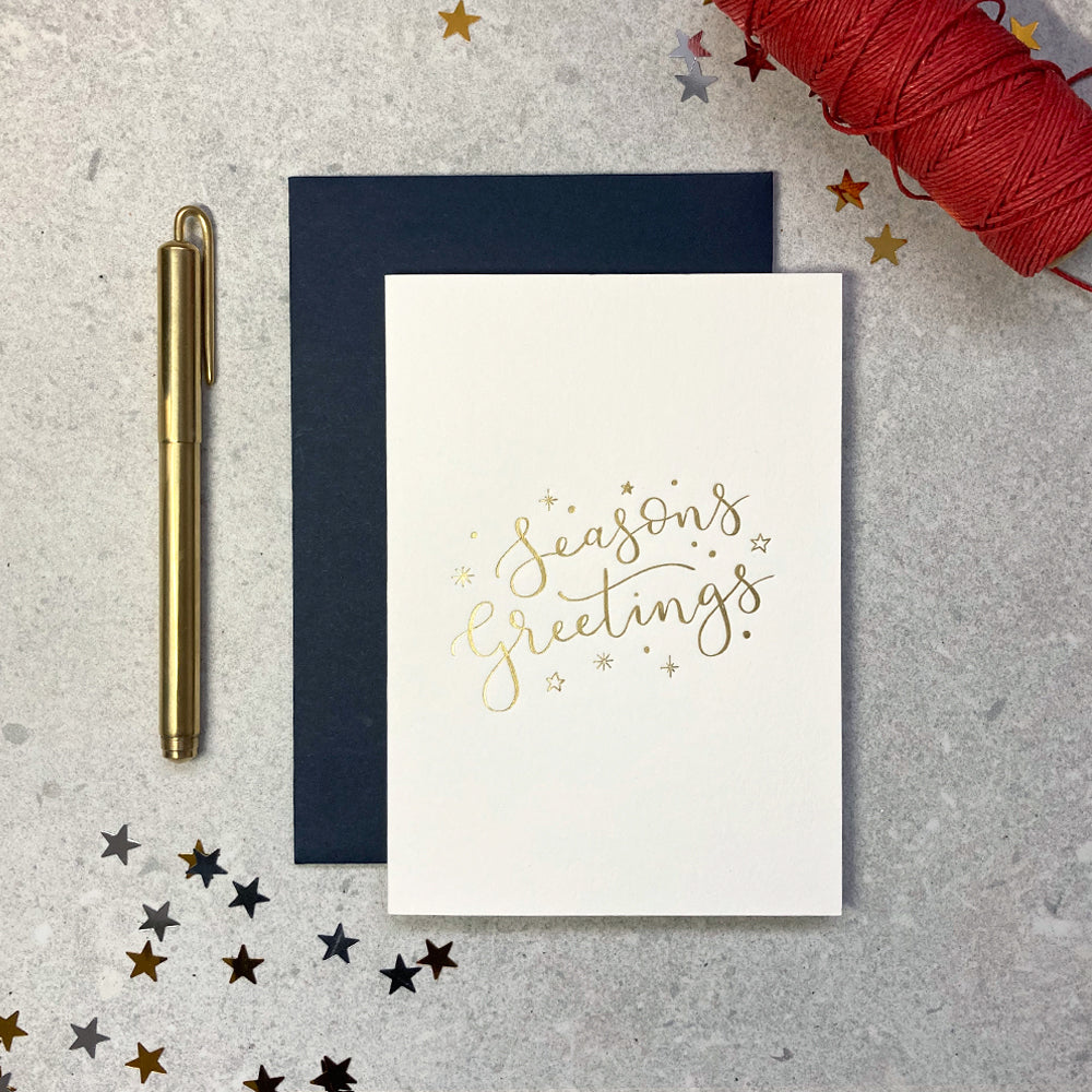 'season's greetings' letterpress foiled ivory card