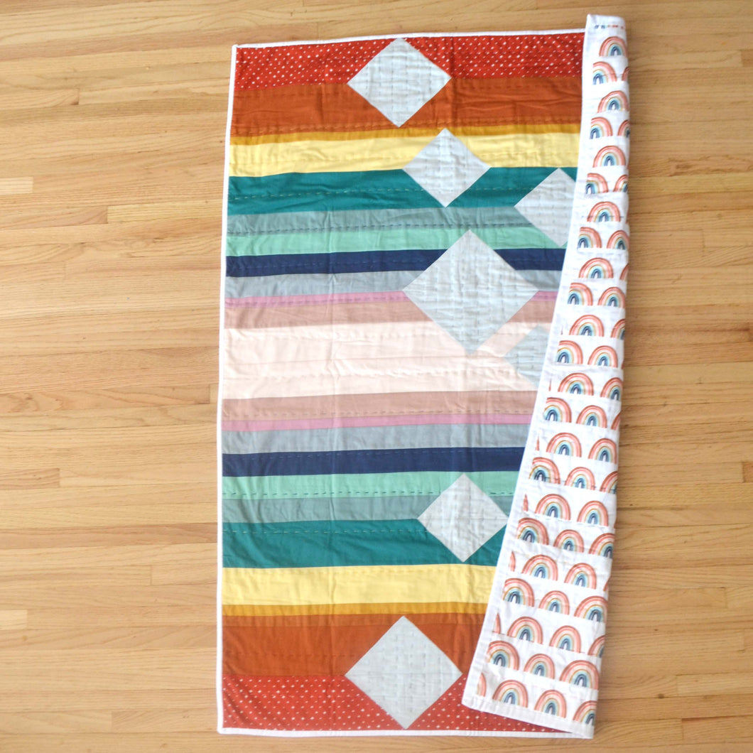 Rainbow Crib Quilt: Hand quilted