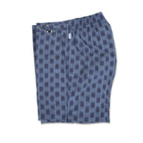 Mid length flat front nylon swim trunk with ikat print motif