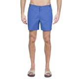 Mid length flat front nylon swim trunk with tricolor repetitive square print