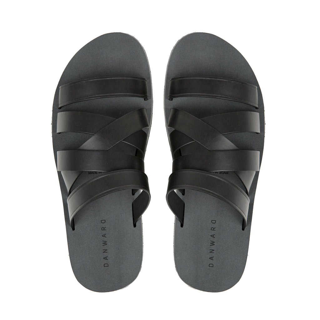 Black leather asymmetrical multi-strapped sandal with micro sole