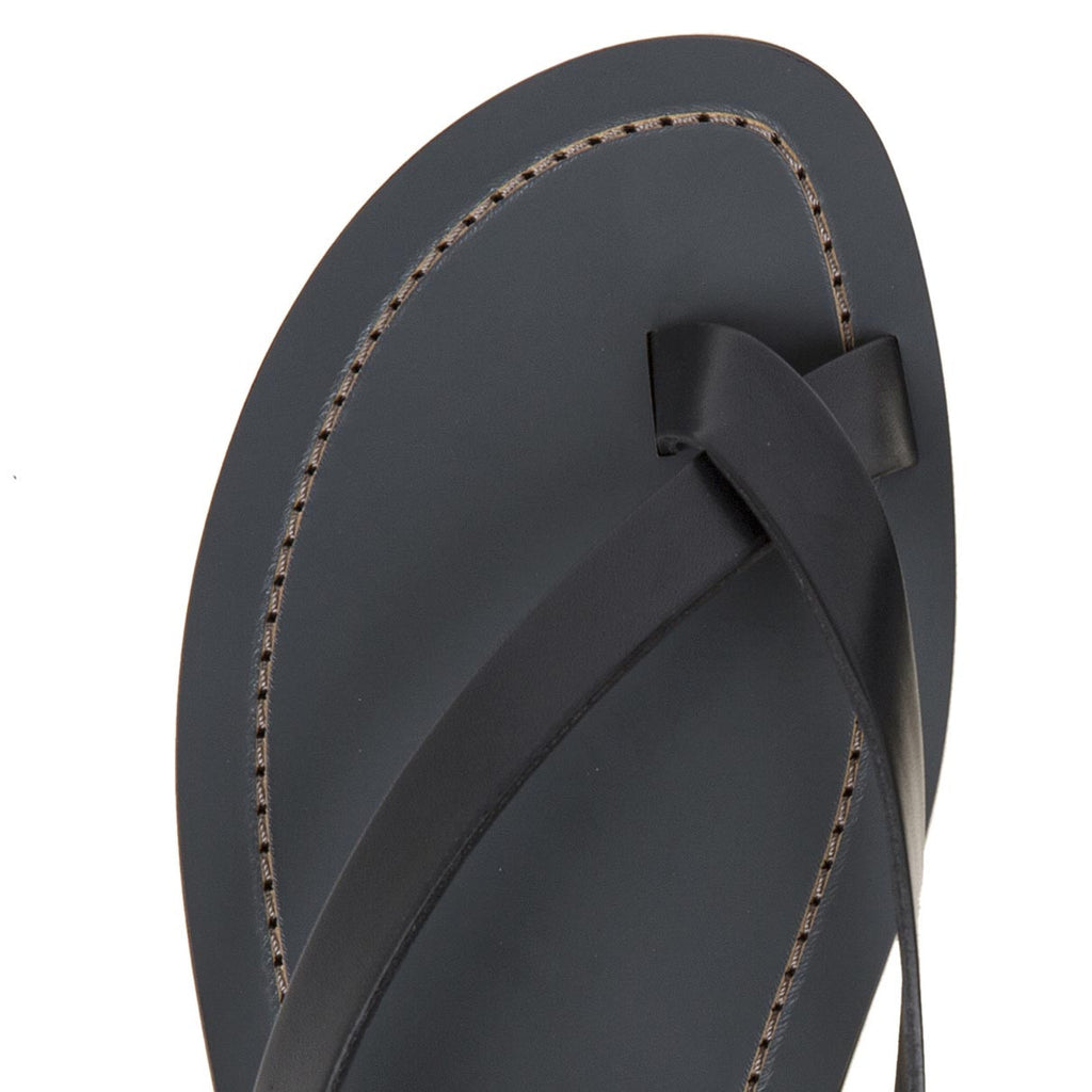 Elegant leather cross-toe sandal with half rubber heal