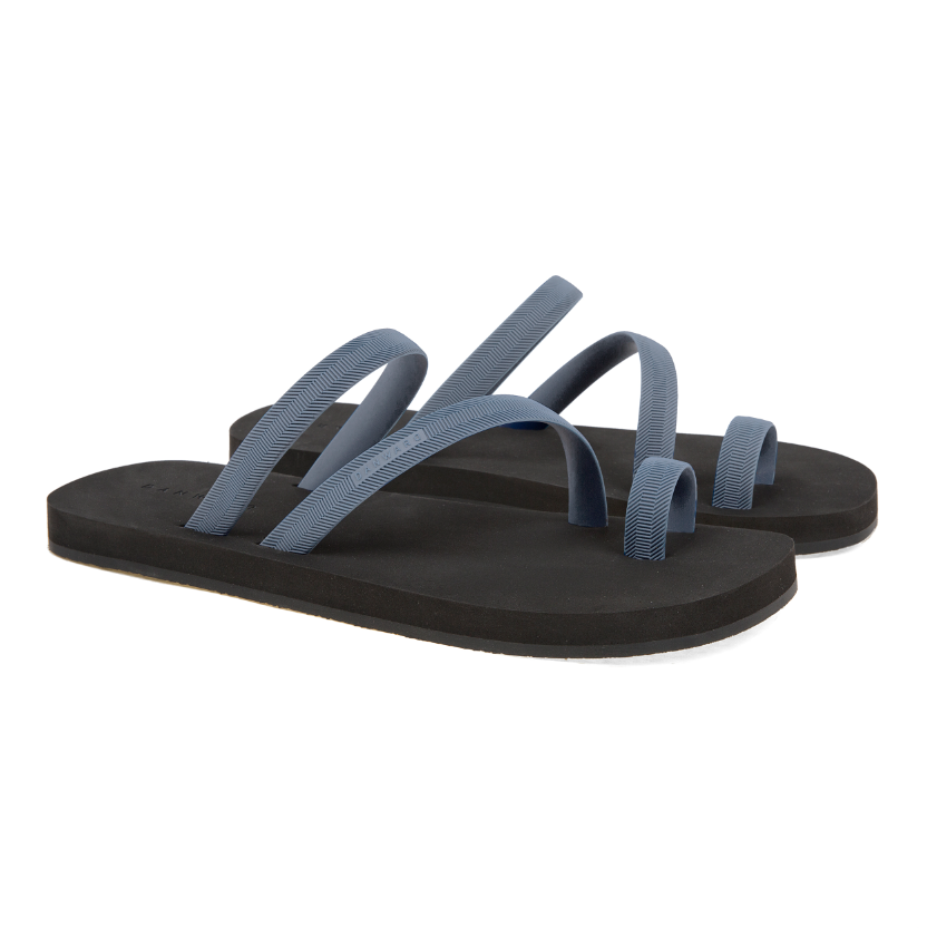 Bicolored luxe flip flop with asymmetric caged upper