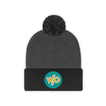 Warrior Princess Pom Pom Beanie Hat - Turquoise Circle Logo