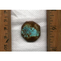 A lovely blue turquoise cabochon with red spiderweb matrix from Stone Mountain Mine.