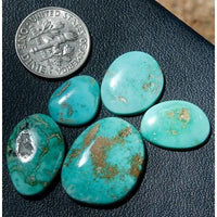 5 natural turquoise nuggets from Blue June fashioned into a lovely medium-blue turquoise cabochon suite.