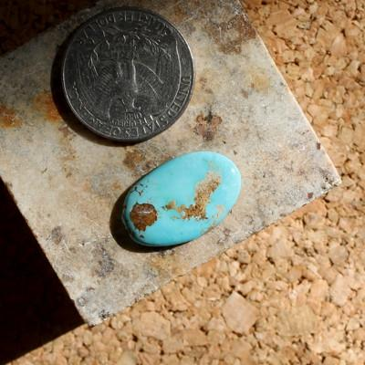 Sky blue contrasts red and tan on this Stone Mountain Turquoise cabochon