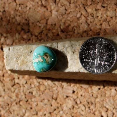 Blue contrasts, green and tan on this Stone Mountain Turquoise freeform cabochon