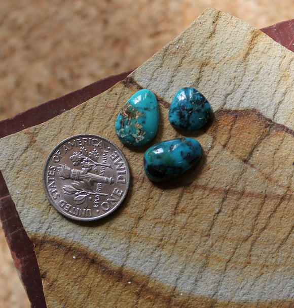 A trio of natural blue McGinnis turquoise cabochons