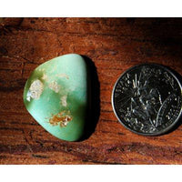 A turquoise cabochon by the Nevada Cassidys. This is a interesting variety of the turquoise found at Stone Mountain Mine that bears a signature red iron patterning.