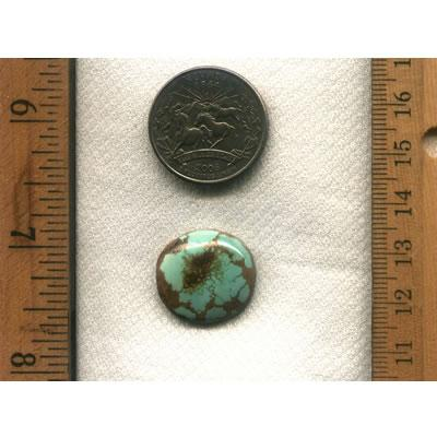 A round light blue turquoise cabochon with very interesting red inclusions . All natural turquoise from northern Nevada.